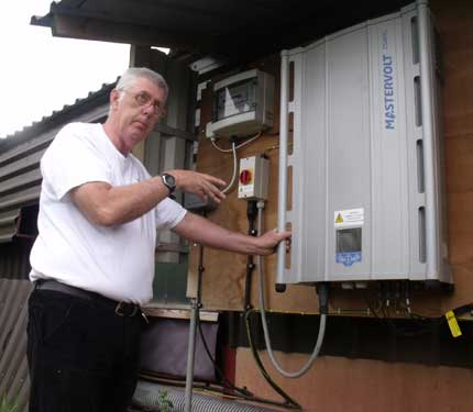 Explaining how an inverter works at a community owned PV scheme